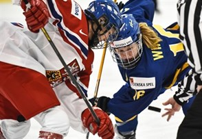 KAMLOOPS, BC - MARCH 28: Sweden's Pernilla Winberg #16 and Czech Republic's Klara Hymlarova #12 face off during preliminary round action at the 2016 IIHF Ice Hockey Women's World Championship. (Photo by Matt Zambonin/HHOF-IIHF Images)