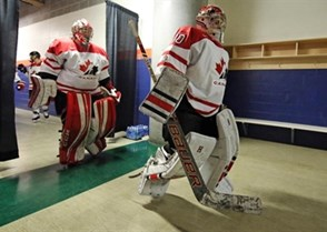 KAMLOOPS, BC - MARCH 28: Canada's Emerance Maschmeyer #30 and Charline Labonte #32 walk down corridor prior to preliminary round action against the U.S. at the 2016 IIHF Ice Hockey Women's World Championship. (Photo by Andre Ringuette/HHOF-IIHF Images)