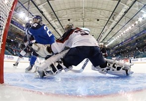 KAMLOOPS, BC - MARCH 29: Finland's Michelle Karvinen #21 scores a first period goal against USA's Jessie Vetter #31 during preliminary round action at the 2016 IIHF Ice Hockey Women's World Championship. (Photo by Andre Ringuette/HHOF-IIHF Images)