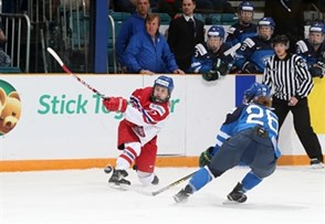 KAMLOOPS, BC - APRIL 1: Anna Zikova #27 of the Czech Republic lets a shot go while Finland's Saana Valkama #26 defends during quarterfinal round action at the 2016 IIHF Ice Hockey Women's World Championship. (Photo by Andre Ringuette/HHOF-IIHF Images)